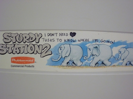 "Graffiti of the phrase: ""I don't need tusks to know where I'm going"" written on a baby changing station with elephant drawings"