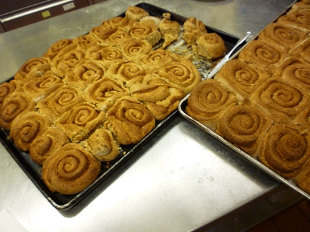 Sheet pans of baked cinnamon rolls
