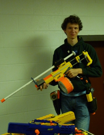 A student poses with a nerf gun