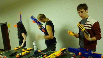 Students inspect nerf guns