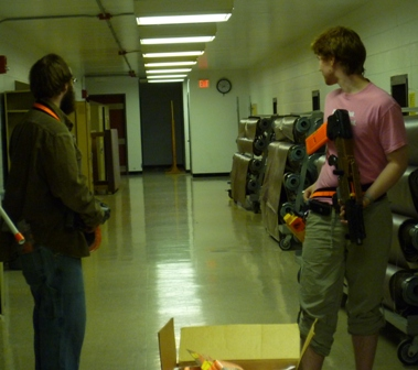 Two students hold nerf guns