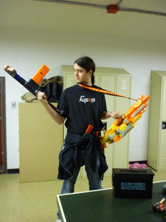 A student holds two nerf guns