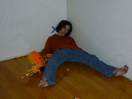 A student plays dead on the ground
