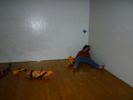 The student playing dead in a corner