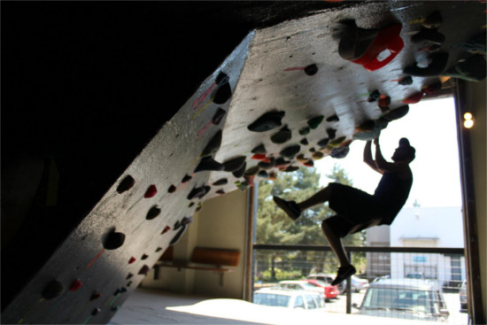 Person rock climbing on an indoor wall