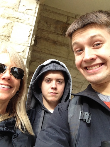 The author taking a selfie with his brother and mom