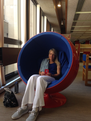 The authors mom sitting in a womb chair