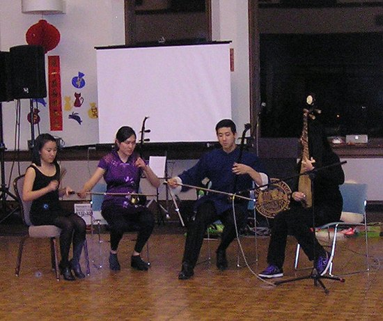 4 musicians playing instruments