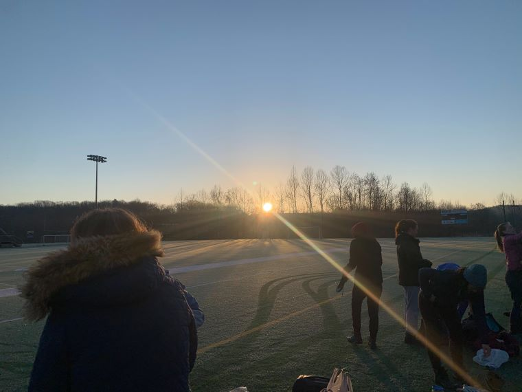 The sun rises over a frosted field
