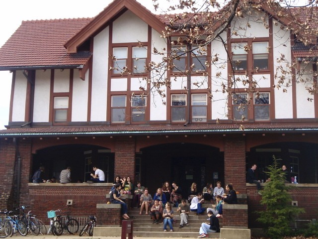 Students sit outside of Keep Cottage