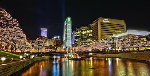 Downtown Omaha at night with lights.