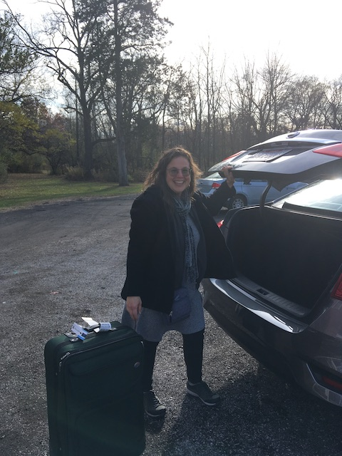 My mom arriving to Oberlin and taking a suitcase out of her rental car