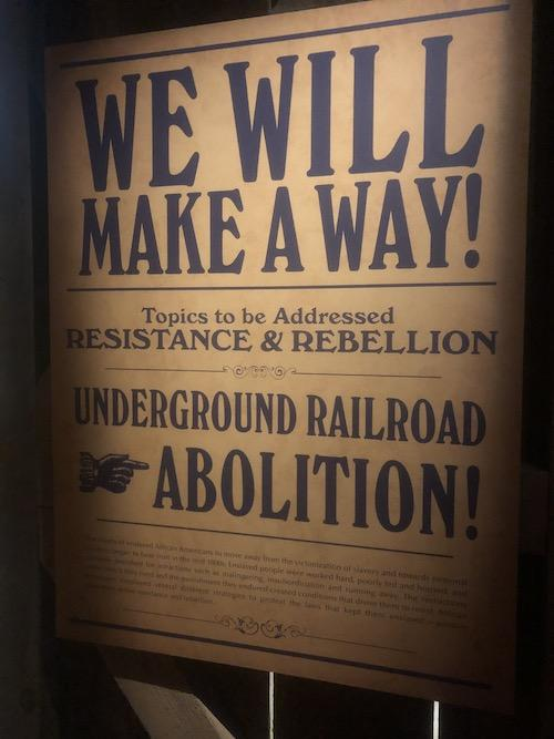 "A photo of a text panel in the Wright Museum, reading ""We Will Make Away! Topics to be addressed: Resistance & Rebellion, Underground Railroad, Abolition!"""
