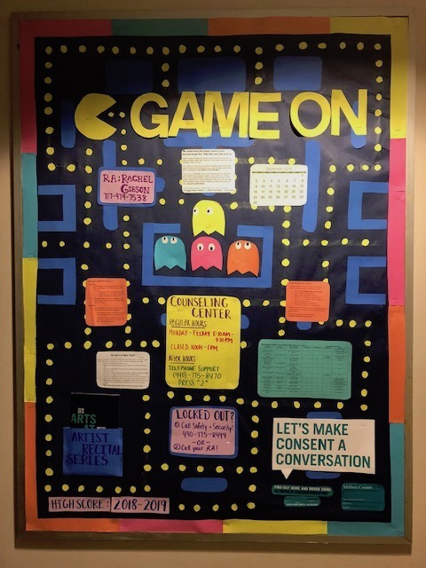 A bulletin board with Pac-Man on it.