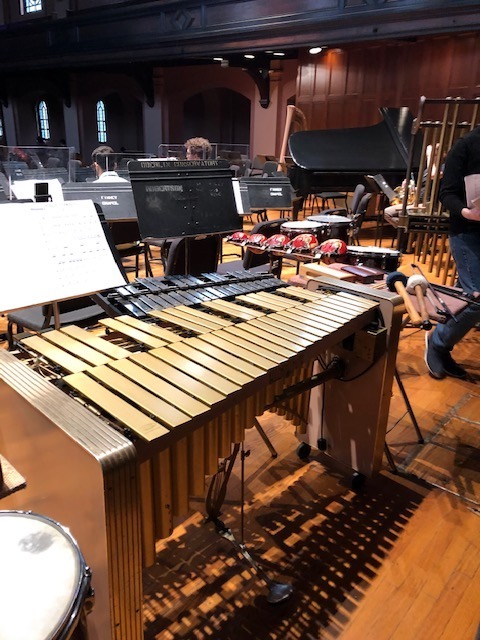 A vibraphone and other small percussion instruments on a stage.