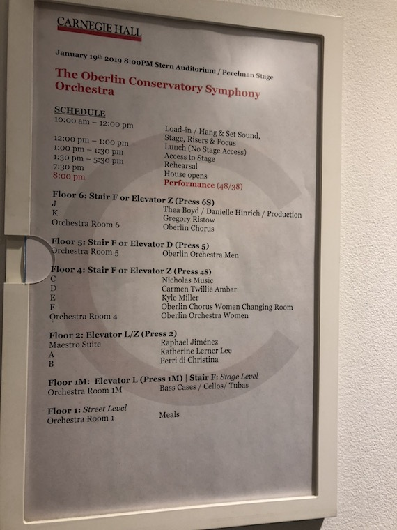 A schedule on the wall of Carnegie Hall.