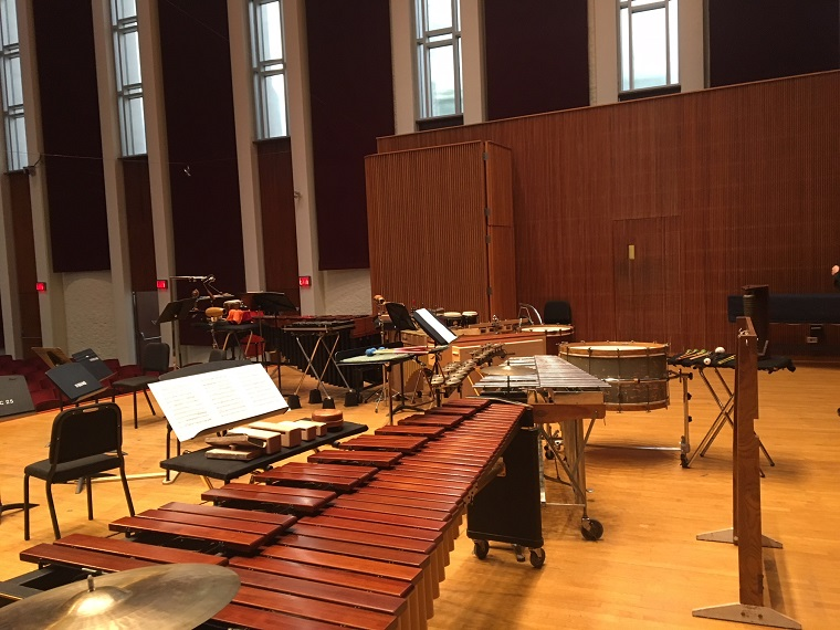 Percussion instruments set up on a stage.