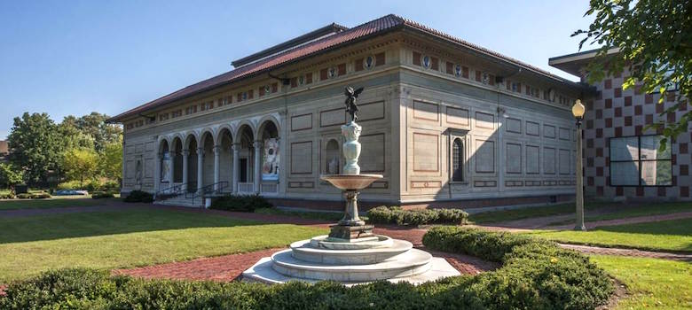 A photo of the Allen Memorial Art Museum building with a fountain in front of it