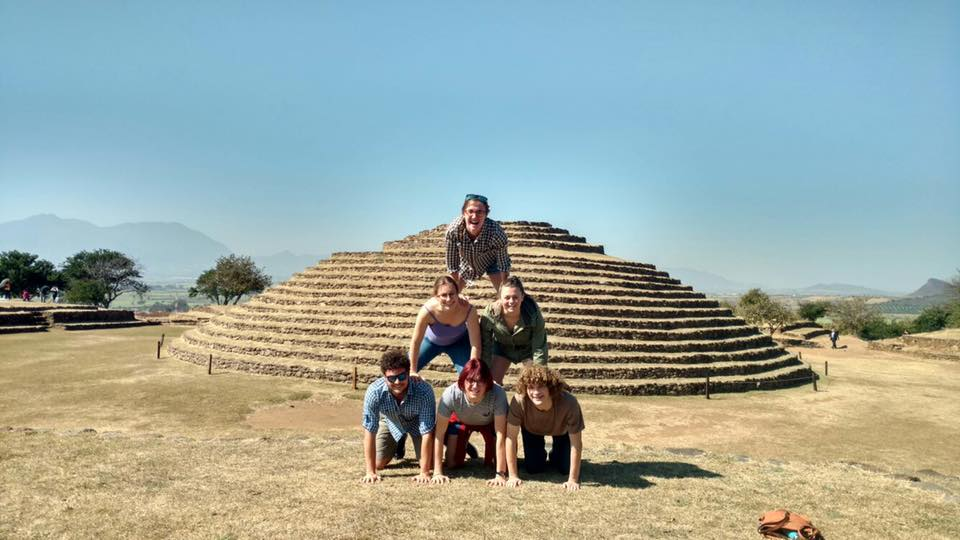 A pyramid of students in front of a pyramid
