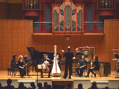 contemporary music ensemble in concert on stage. photo.