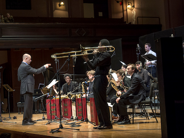 director leads student jazz performance. photo.