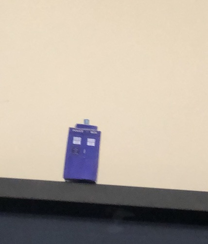 Doctor Who TARDIS sitting on top of a TV.