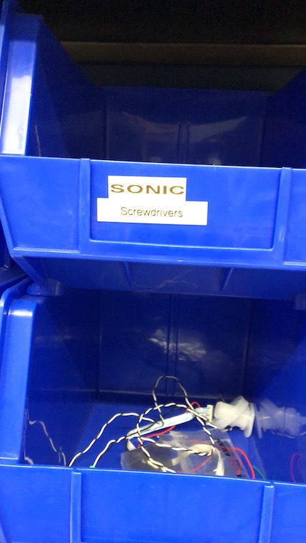 "A box with a label ""Sonic Screwdrivers"" on it."