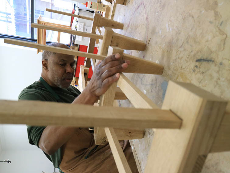 johnny coleman building wooden chairs