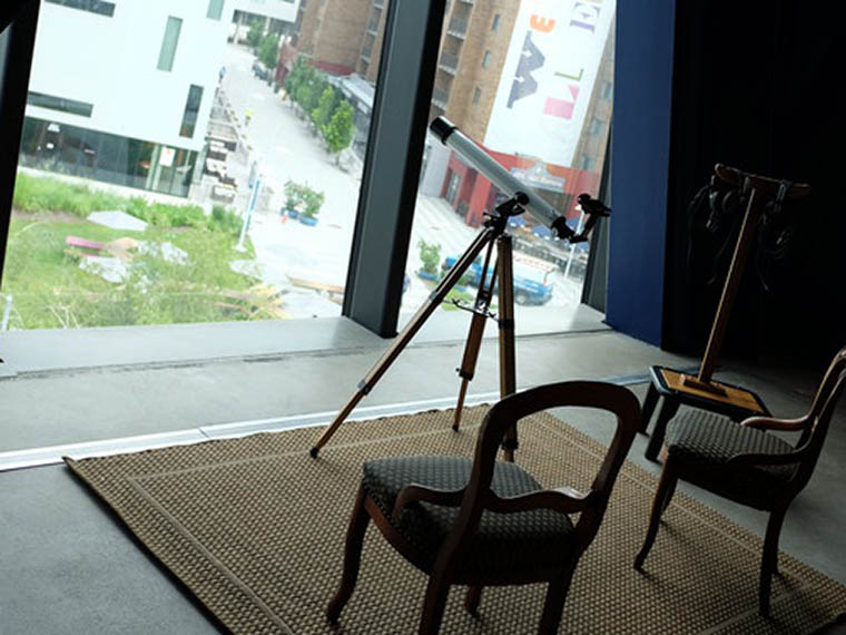 two chairs and a telescope