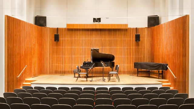 Piano on stage in an intimate hall
