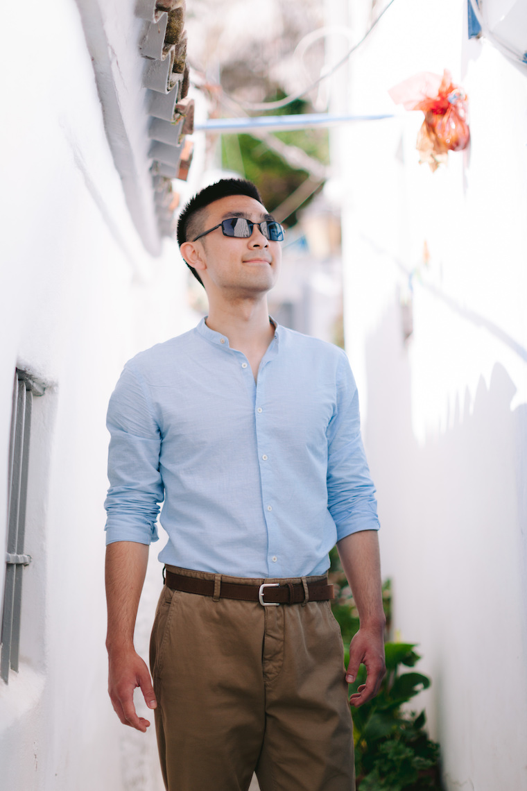 Photo of Charles Cui standing in a brightly-lit street and looking away from the camera