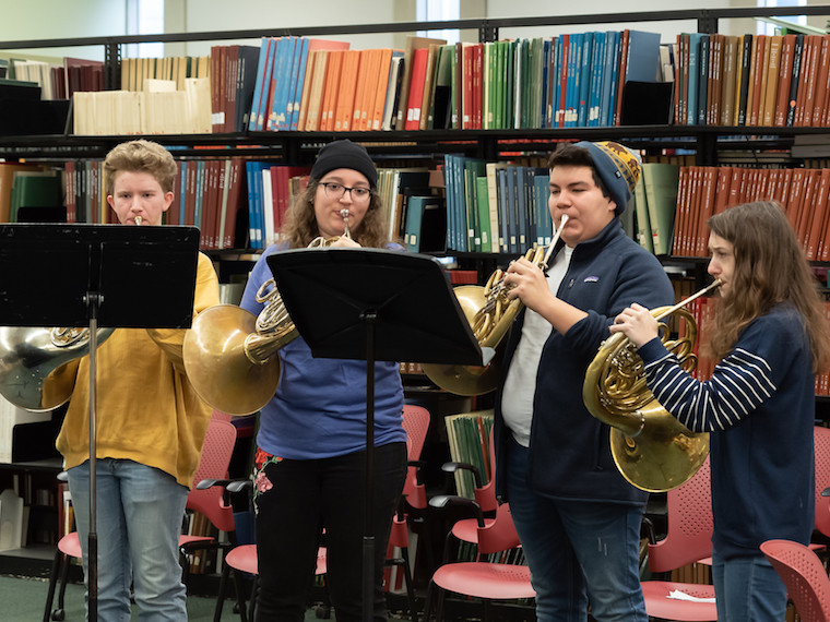 Students playing French horns,