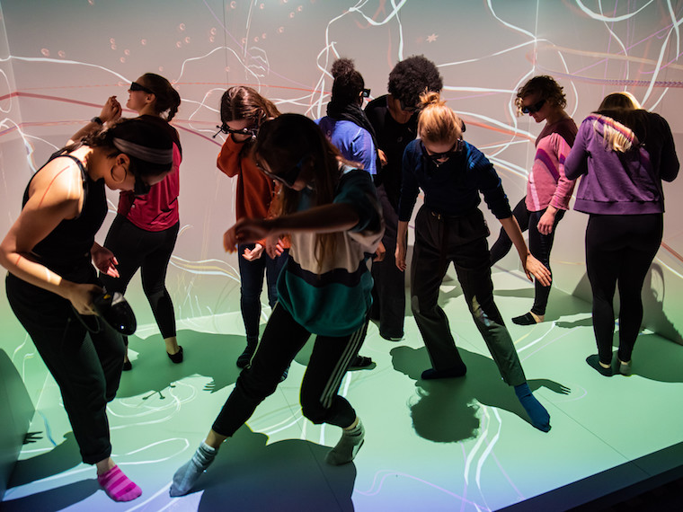 Students dance in a virtual room.