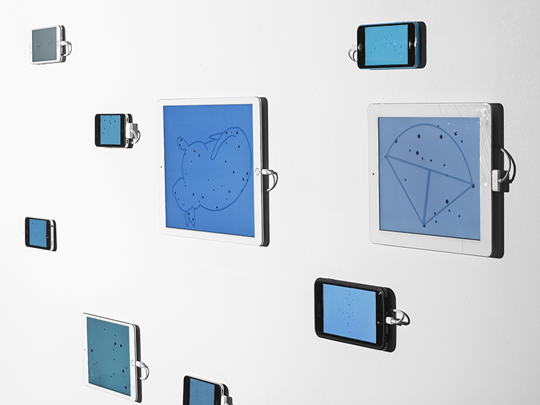 A gallery display of iPhones and iPads showing retired star constellations.