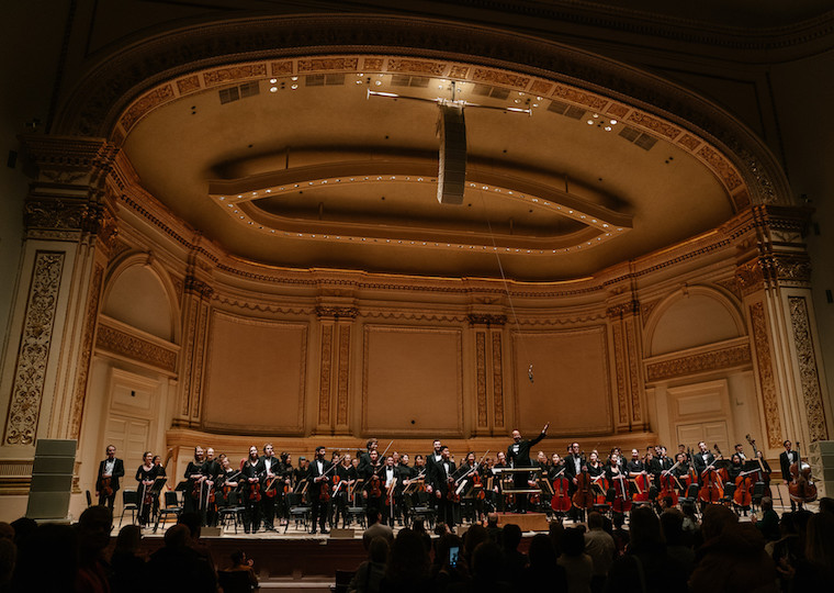The Oberlin Orchestra takes a bow on stage at Carnegie Hall.