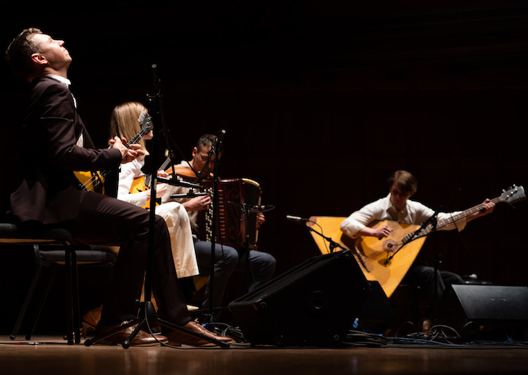 Four classical folk performers give a concert.