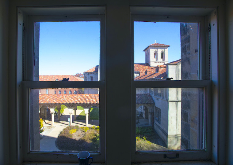 A two-pane window overlooks a courtyard.