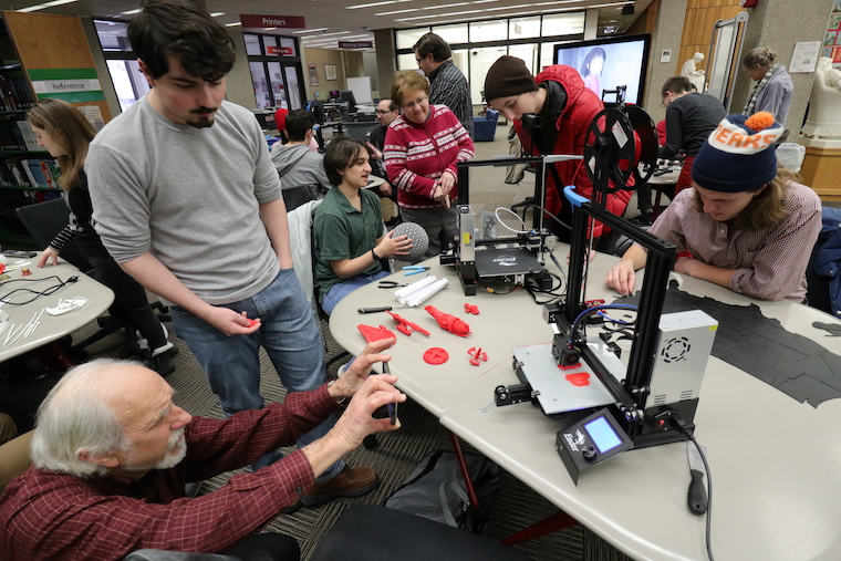 Oberlin students and community members examine 3D-printers in Terrell Main Library