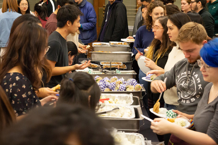 students in line for food at Asian Night Market