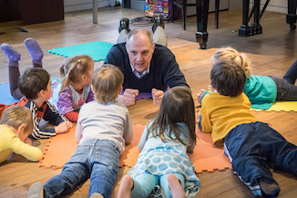 Instructor and toddlers on the floor
