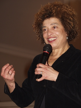 black woman with afro holding mic
