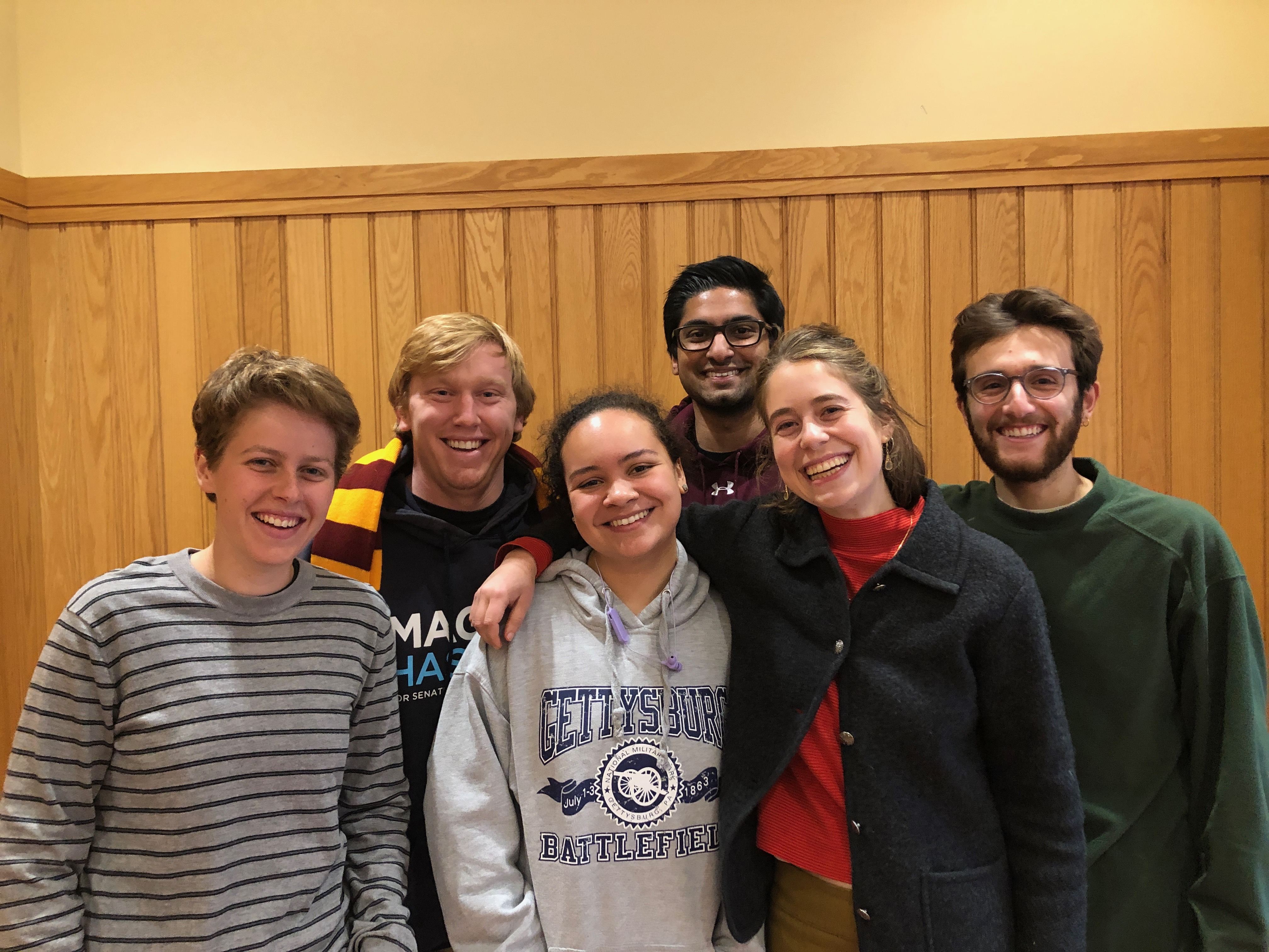 Jonah Gelfand, Nalin Beckman, Noa Gordan-Guterman, Will Cramer, Rehaan Bux, Lucy Brown pose together in the Science Center.