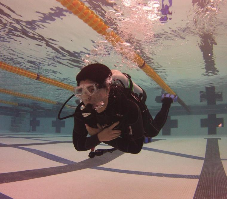 Student scuba diving in a pool