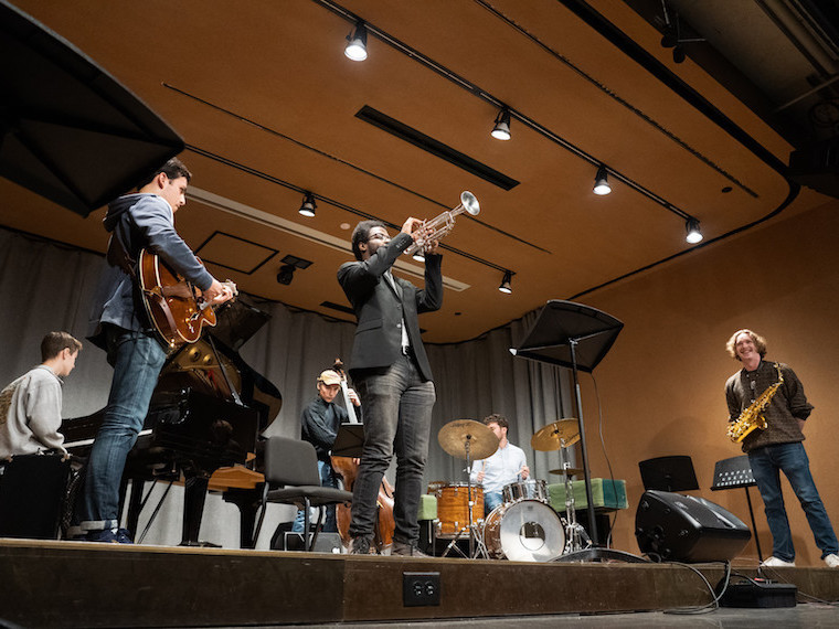 A jazz band plays on stage.