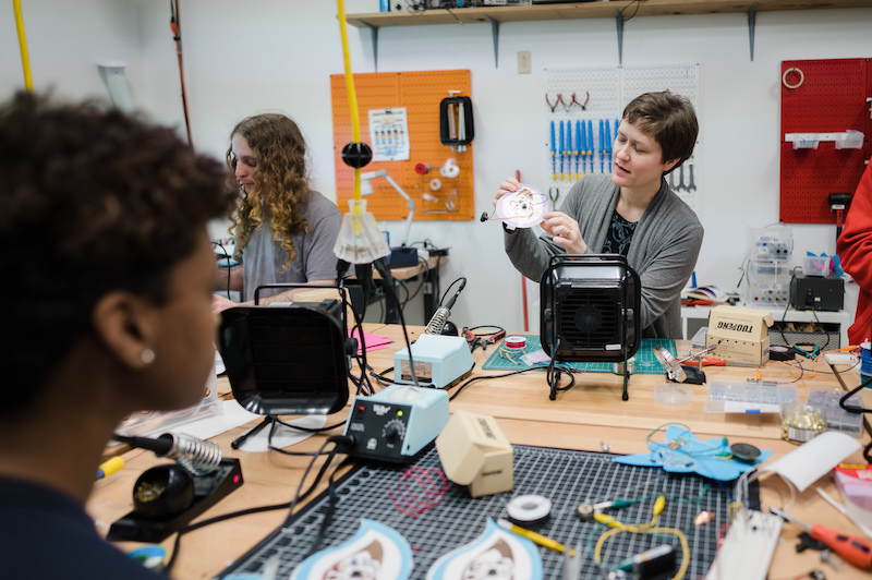 Abby Aresty works with students in TIMARA's makerspace