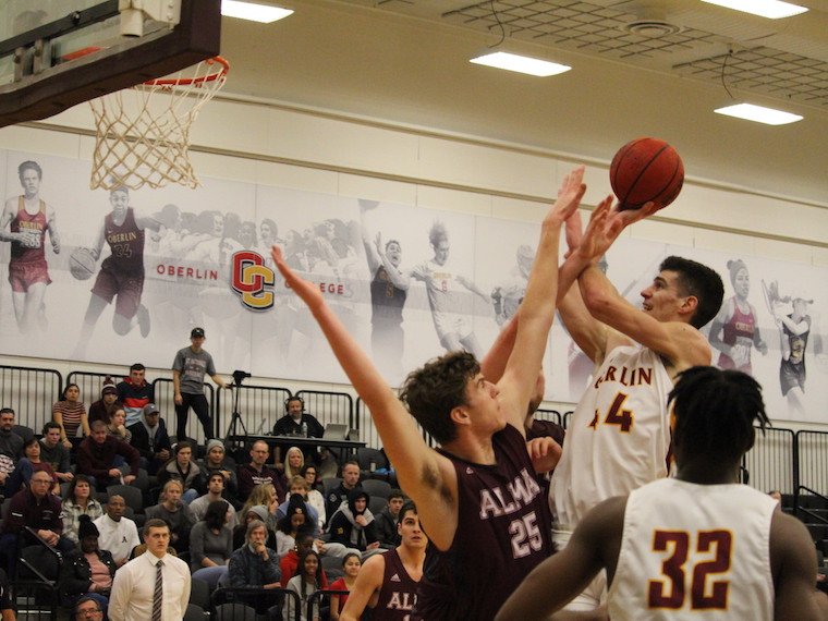An Oberlin basketball player goes for a jump shot.