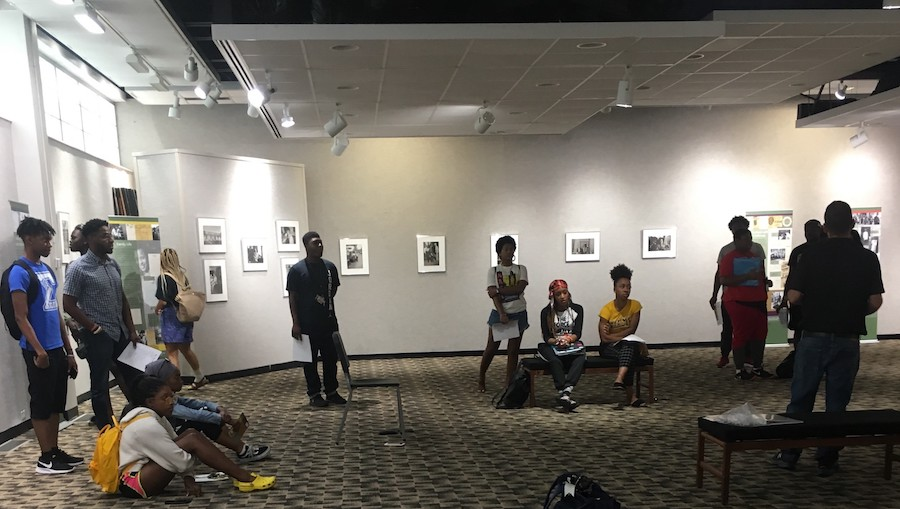 students listening to a lecture in an art gallery