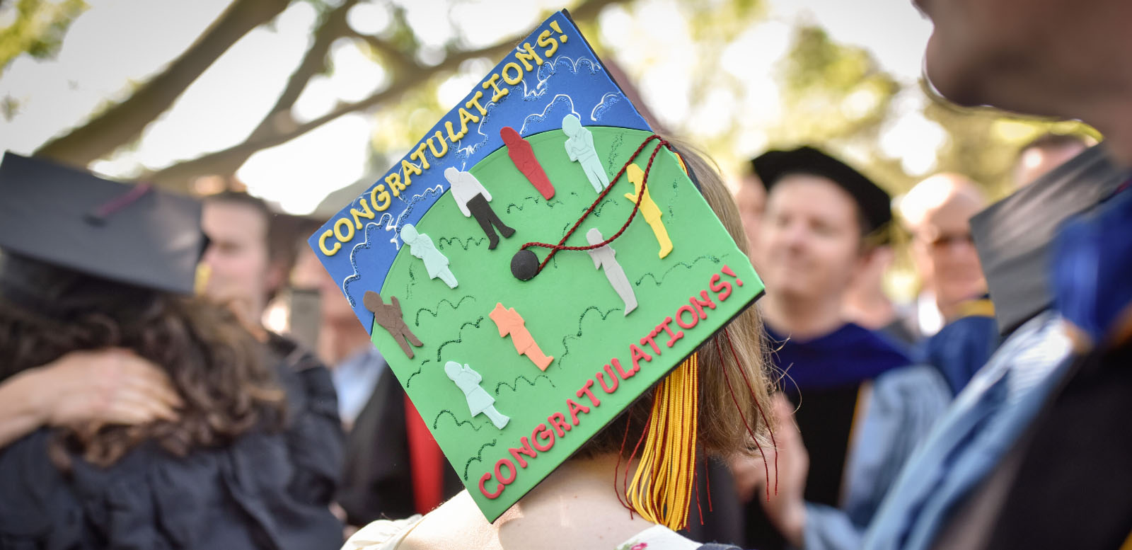 A student-designed graduation cap says 'Congratulations'