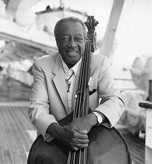 Milt on the deck of a ship with his bass