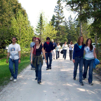 Group of about 10 people strolling along a path